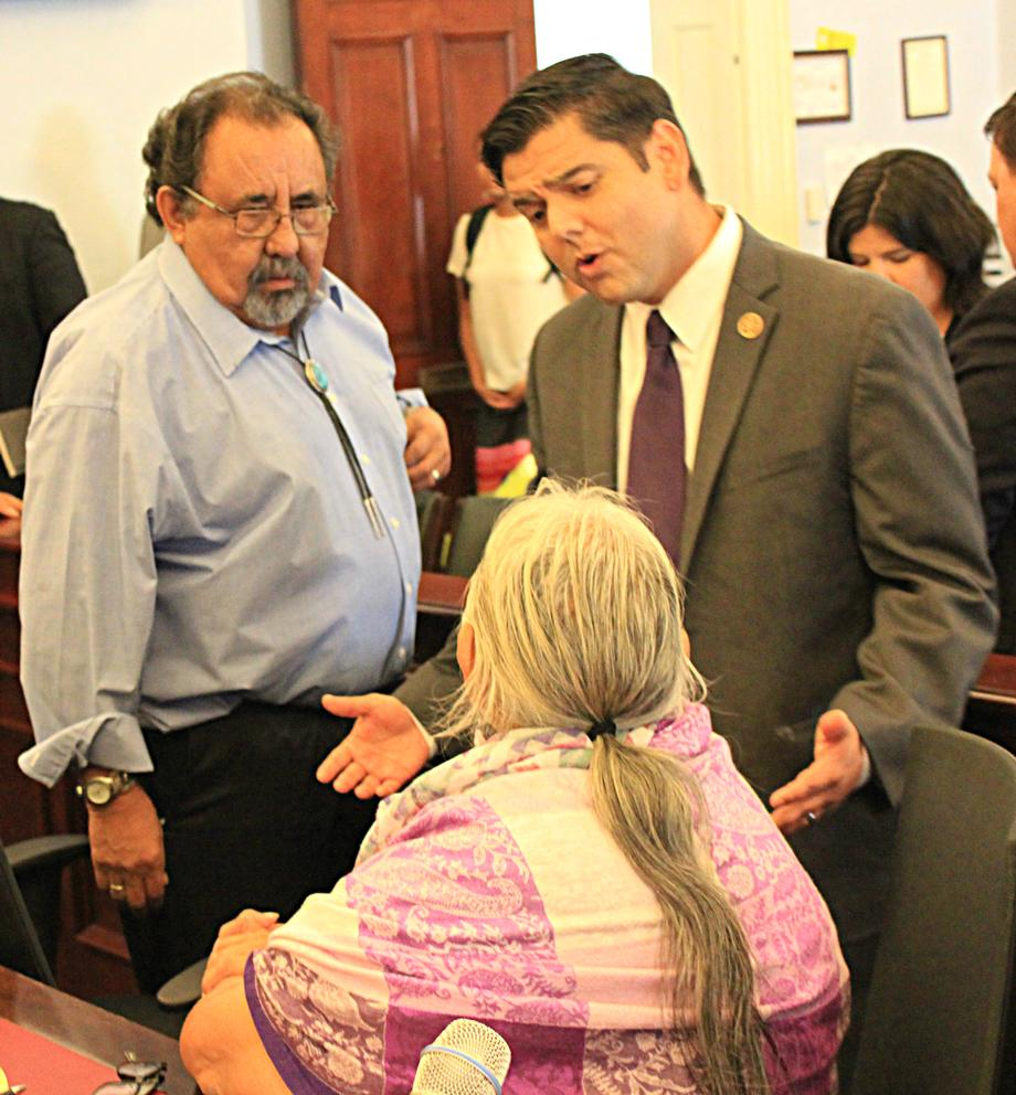 "Representative Raul Ruiz (D-CA) (Back) listens to Faith Spotted Eagle , an Ihanktonwan Oyate Spiritual Leader and Elder, (Front) prior to her testimony at the ""Taking a Stand"" Forum."