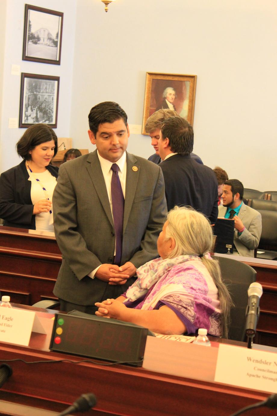 "Representative Raul Ruiz (D-CA) (Back) and Faith Spotted Eagle , an Ihanktonwan Oyate Spiritual Leader and Elder, (Front) discuss the Dakota Access Pipeline prior to the ""Taking a Stand"" Forum."
