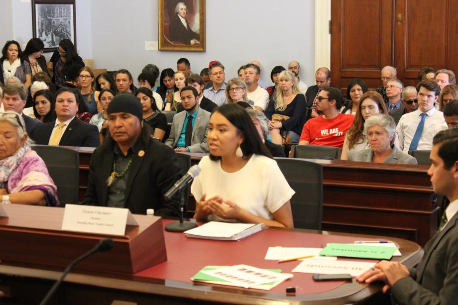 "Gracey Claymore, a member of the Standing Rock Youth Council, (Right) testifies at the ""Taking a Stand"" Forum."